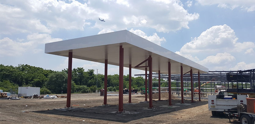 Raising the height of your service station's canopy is often less expensive long term than repeatedly repairing damage caused by collisions with tall vehicles.